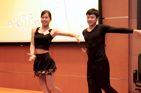 Jasmine (left) giving dance performance during the FIFE Fund Presentation Ceremony and Experience Sharing.